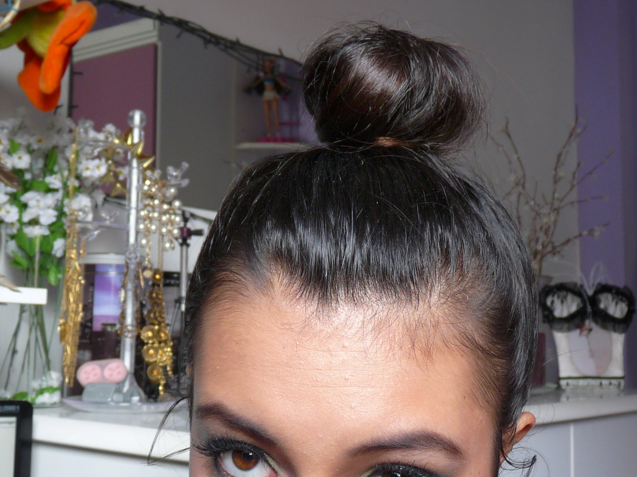 Miley cyrus messy updo hairstyles weekly.
