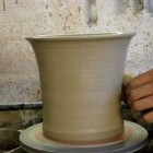 Throwing a clay pottery flower plant pot on a potters wheel demo how to pot throwing flowerpot