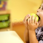 Children and healthy food, baby girl eating fruit at school. Stock Footage